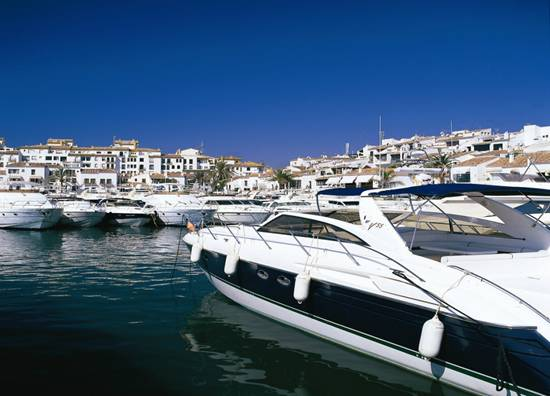 Blue skies all around in Puerto Banus in the Costa del Sol. Weather that is perfect for sailing away...